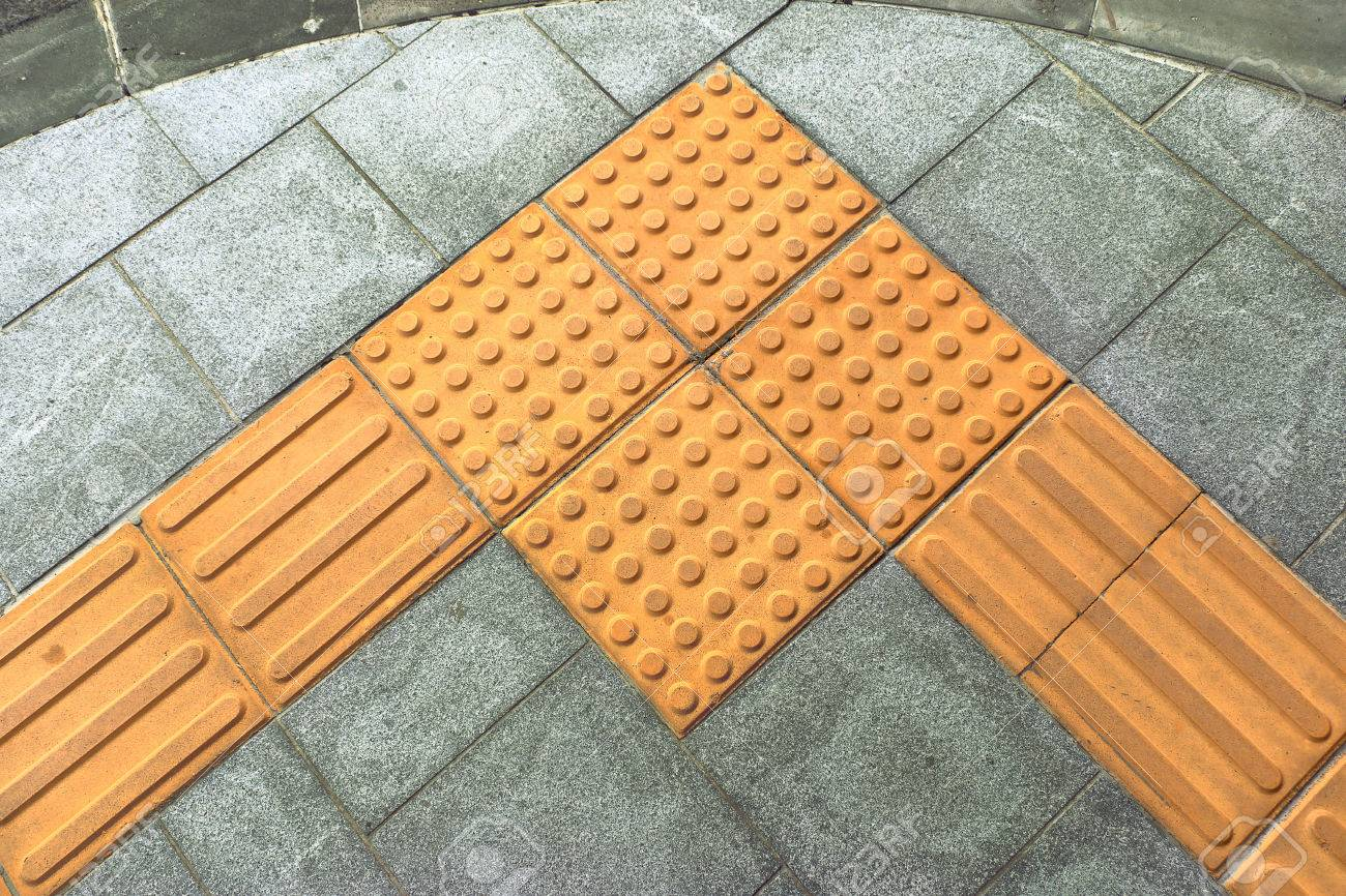 Braille block tactile paving for blind handicap on tiles pathway braille block tactile paving for blind handicap on tiles pathway stock photo 73509660 dailygadgetfo Choice Image