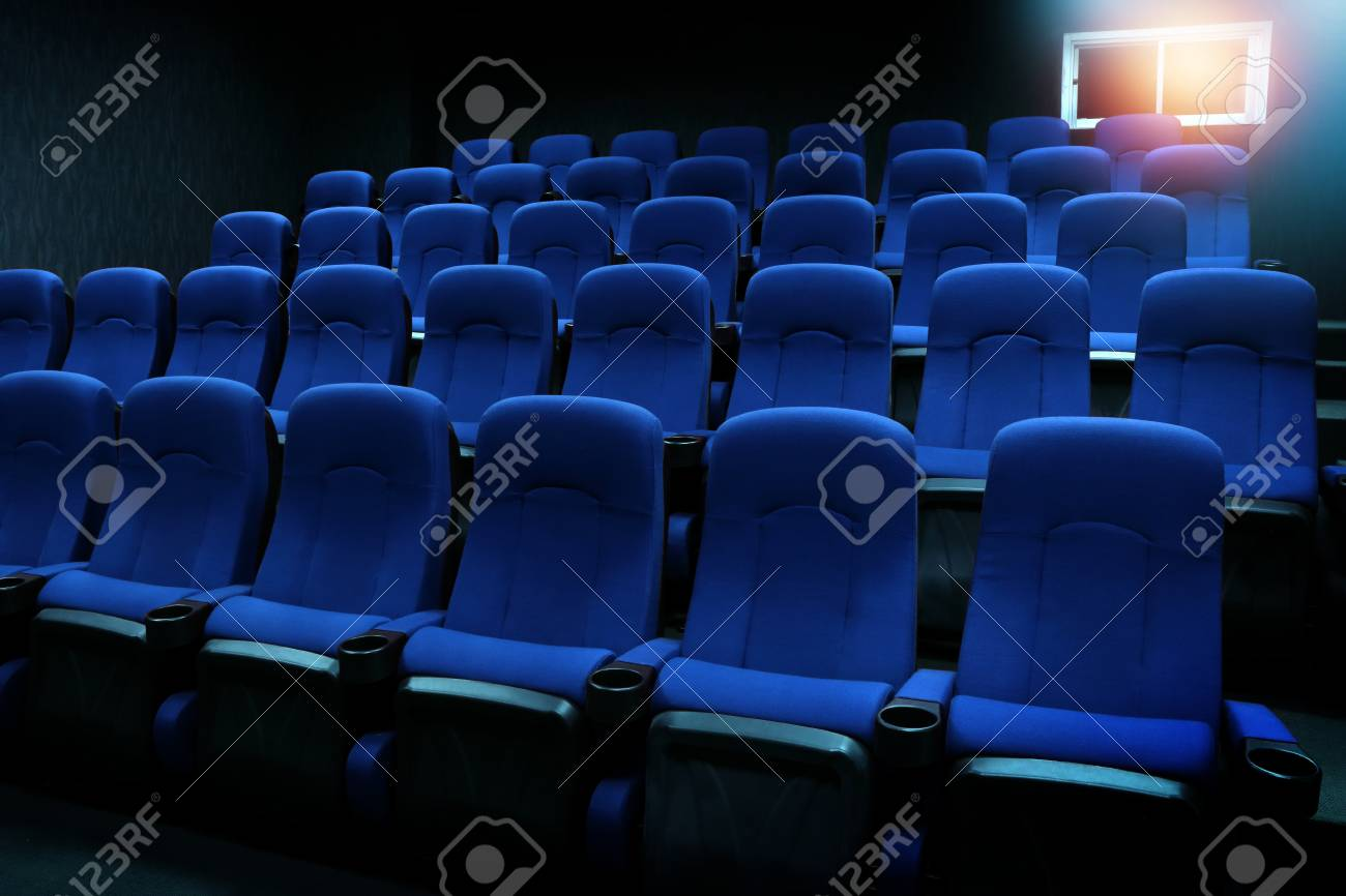 empty new blue seats in auditorium or movie theater stock photo