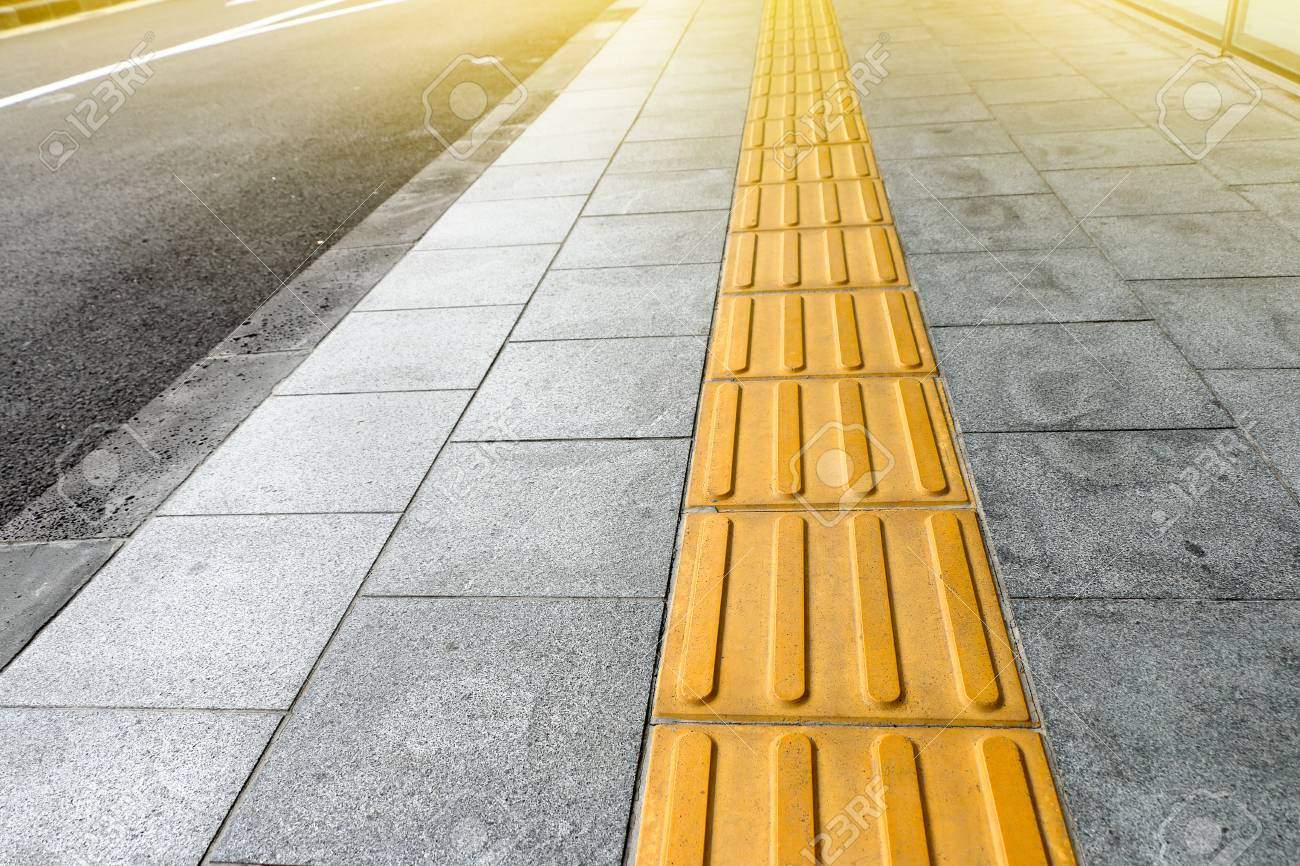 Tactile paving for blind handicap on tiles pathway walkway for tactile paving for blind handicap on tiles pathway walkway for blindness people stock photo dailygadgetfo Choice Image