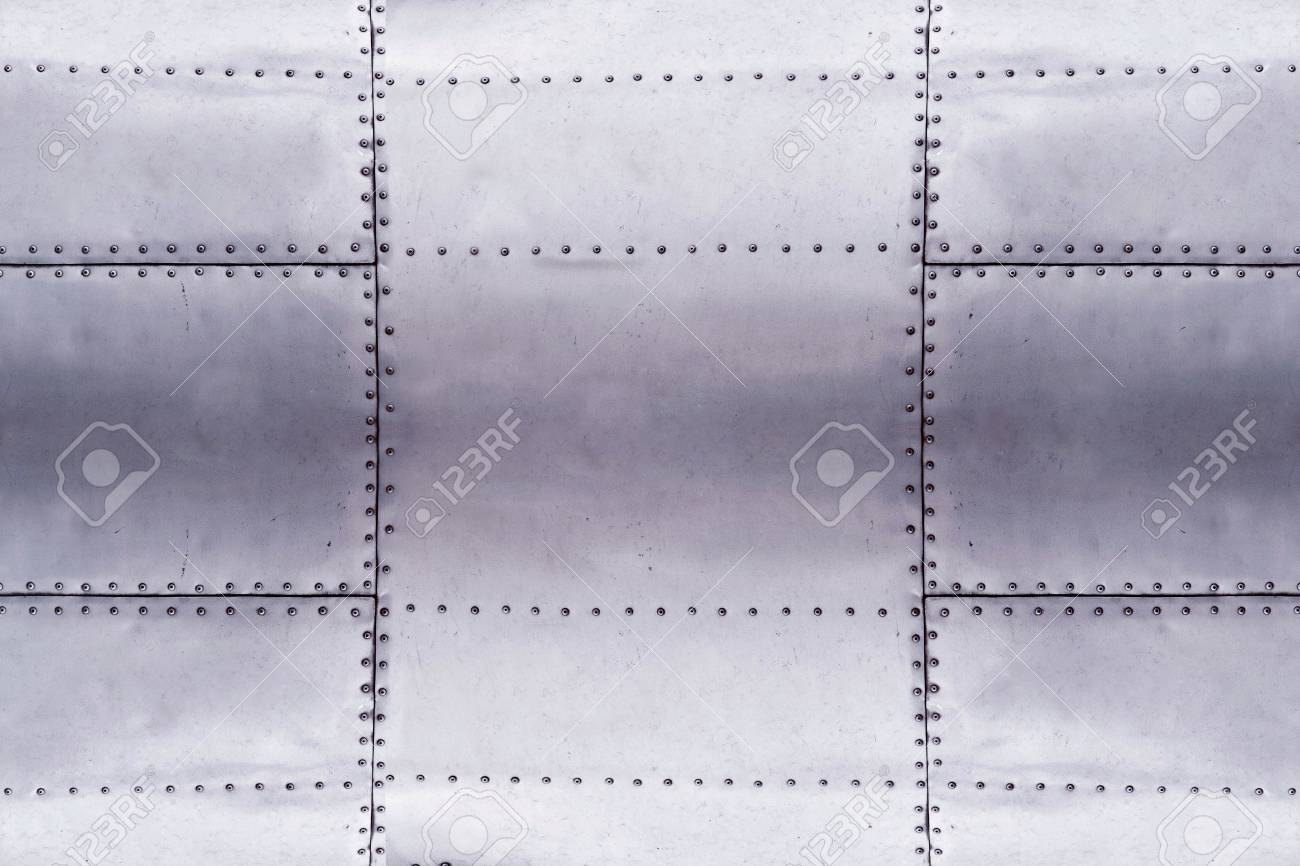 detail of old grunge piece of metal plate with bolts, aluminum surface background - 104457643