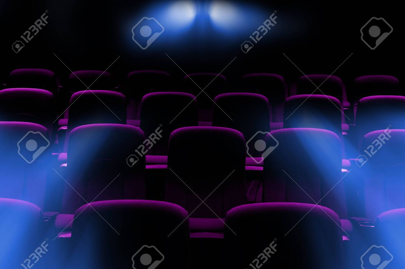 empty movie theater with purple seats with flare light rays from projector - 136321959