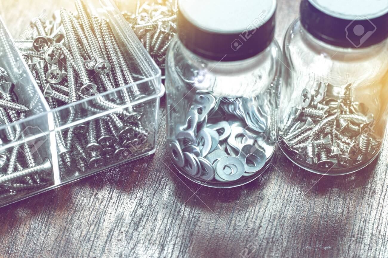 many screws, nuts and bolts in bottle for home use background - 132125768