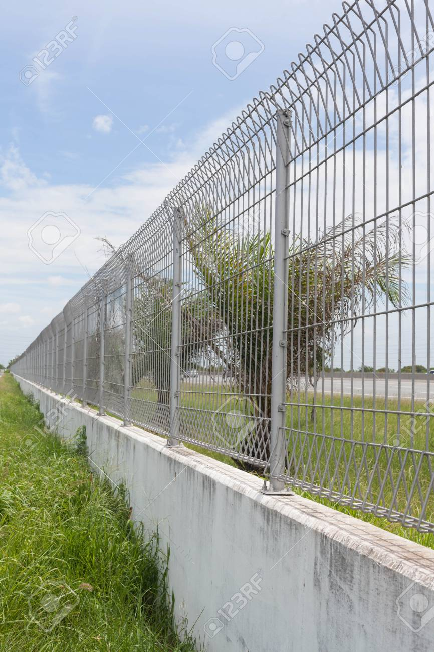 Steel fence along the road Stock Photo - 14216979
