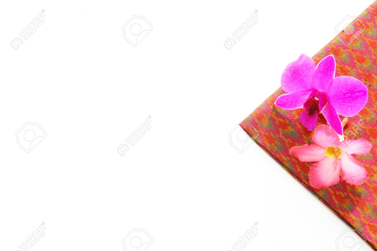 Thailand silk adorned with orchids and Desert Rose Stock Photo - 21953723