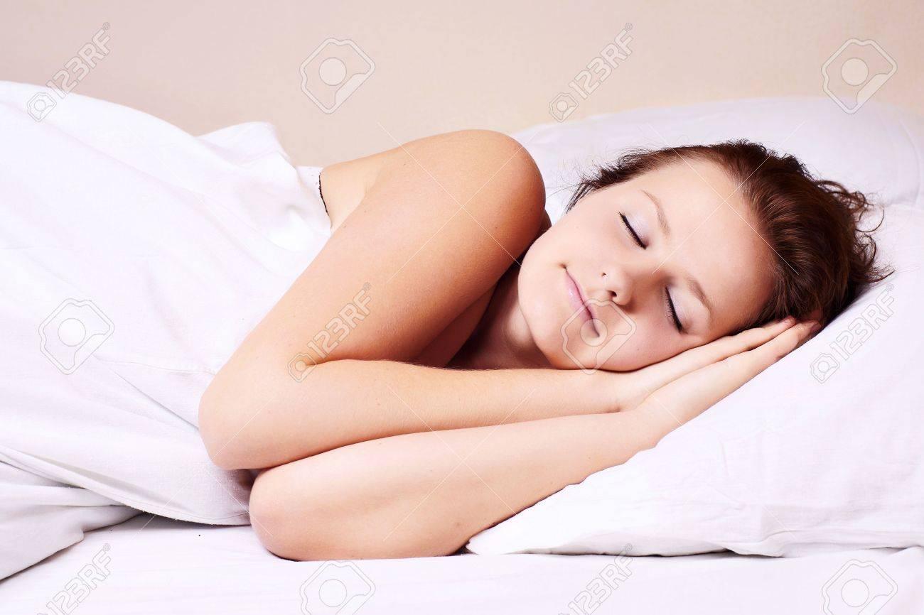 Beautiful woman lying and sleep on the snowy bed Stock Photo - 5622113