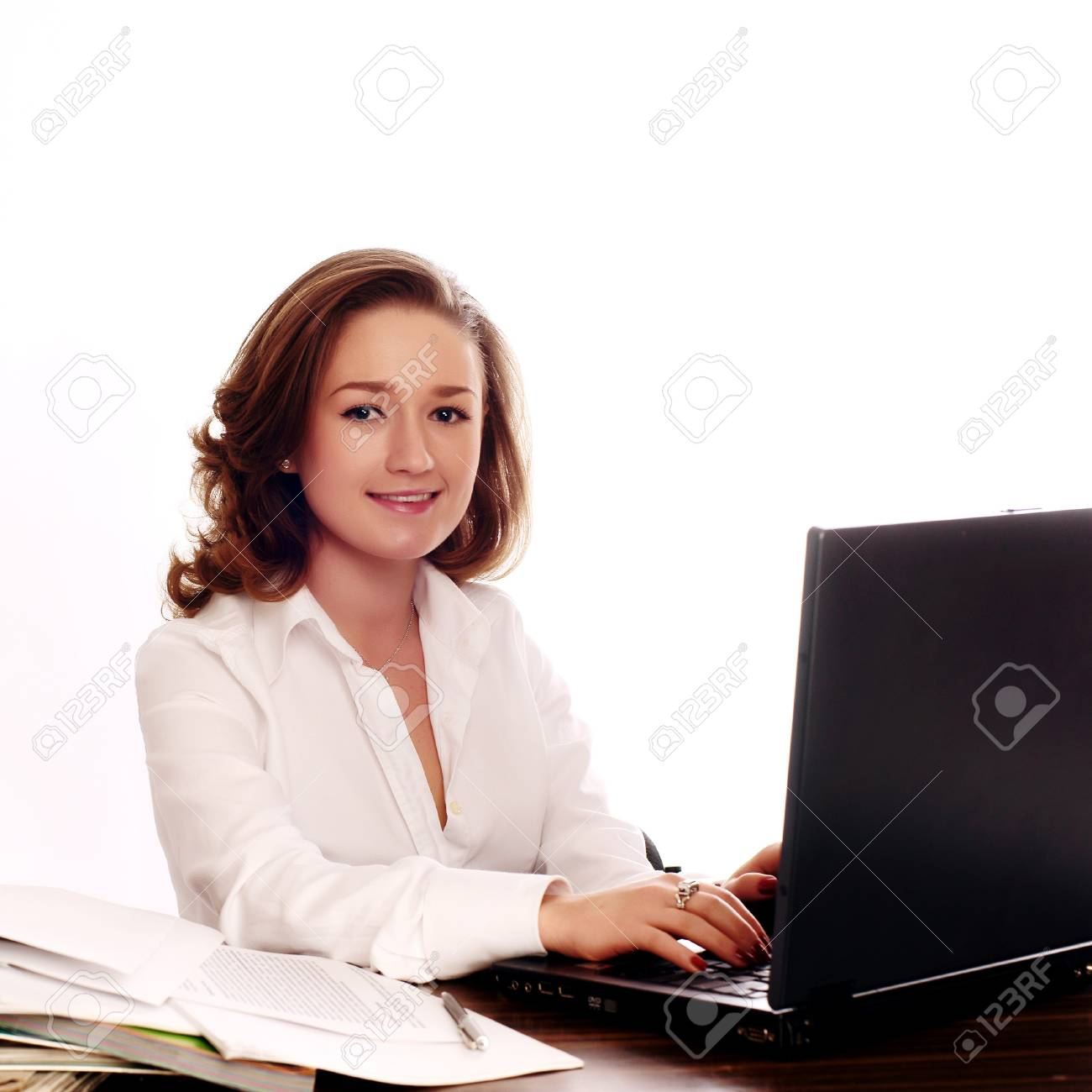 Businesswoman using a laptop and smiling Stock Photo - 7631053