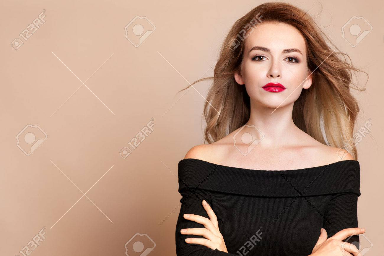 Beautiful young woman with long hair and jewelery. Stock Photo - 45071170