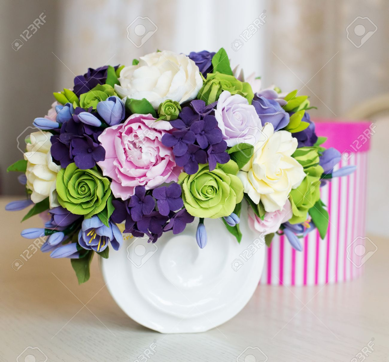 Rose Flower Bouquet And Gift Box On Wooden Table Stock Photo
