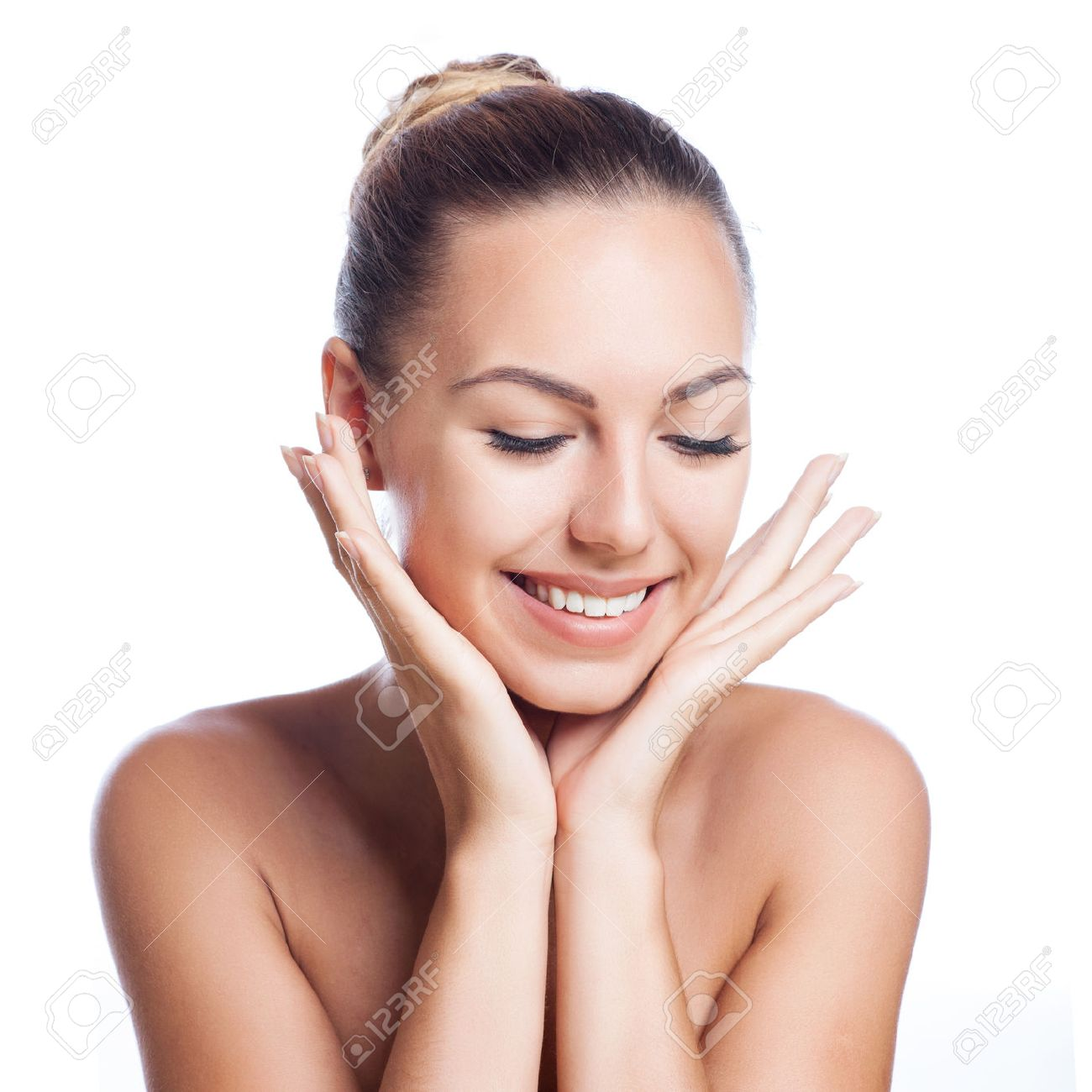 beautiful model applying cosmetic cream treatment on her face on white Stock Photo - 47015955