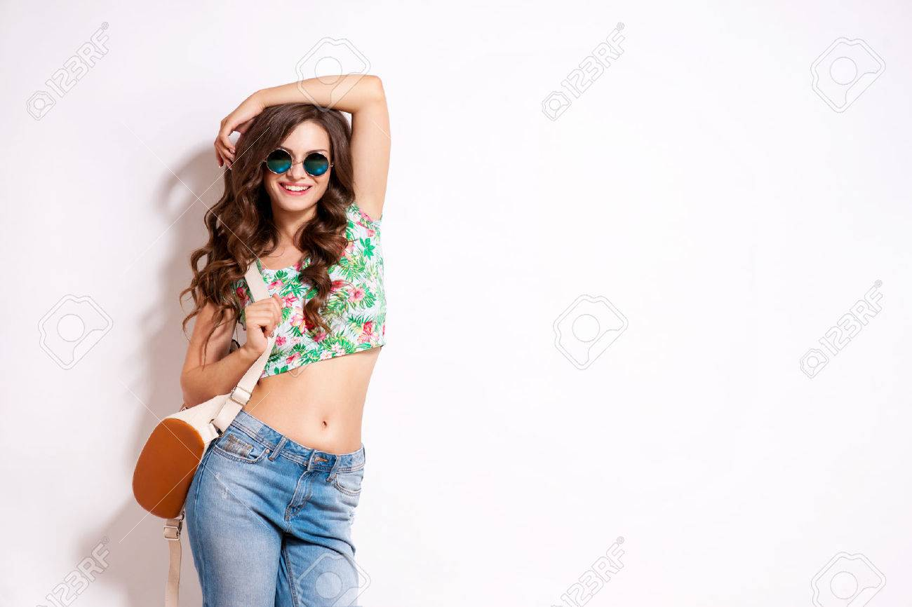 Cool hipster student woman wearing eyewear glasses . Caucasian female university student looking at camera smiling happy. - 63759526