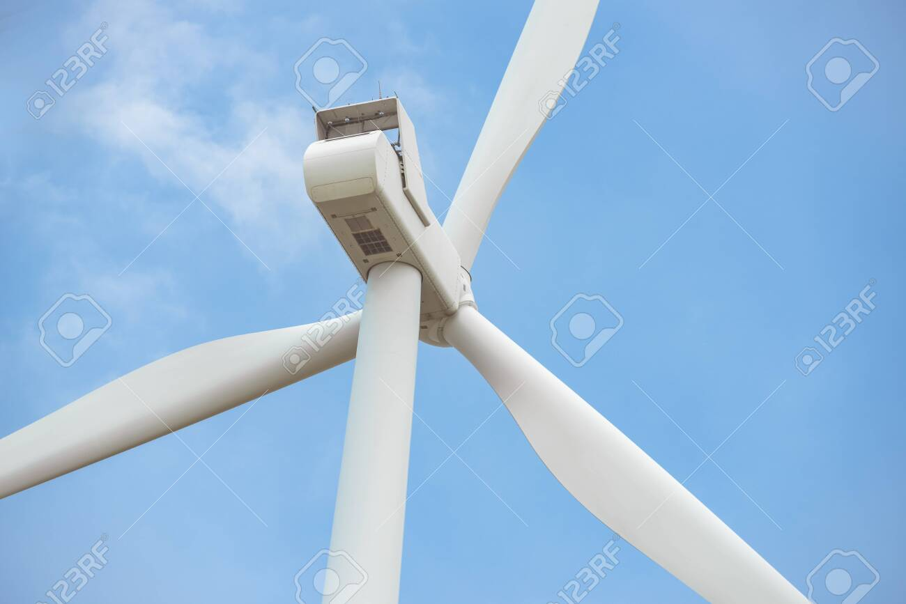 Close-up wind turbine in rotation to generate electricity energy on outdoor with blue sky background, Conservation and sustainable energy concept. - 151325749