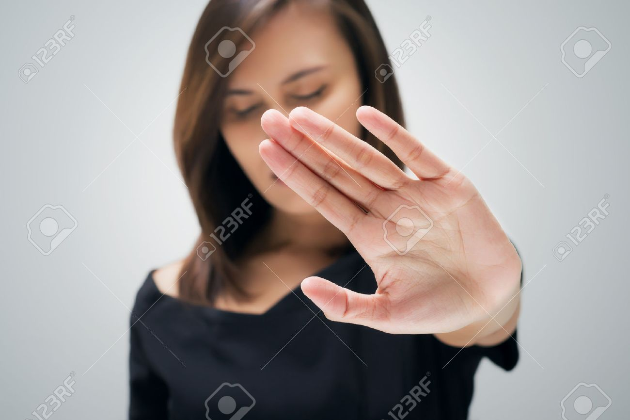 Young Woman Showing Her Denial With NO On Hand Stock Photo
