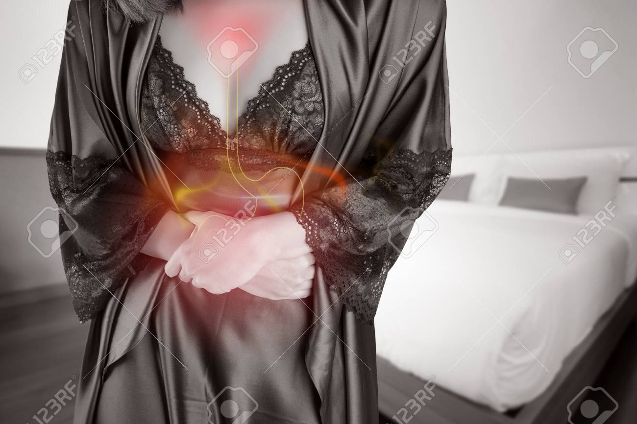 The photo of fire on womans body people with stomach ache problem stock photo the photo of fire on womans body people with stomach ache problem concept female anatomy ccuart Choice Image