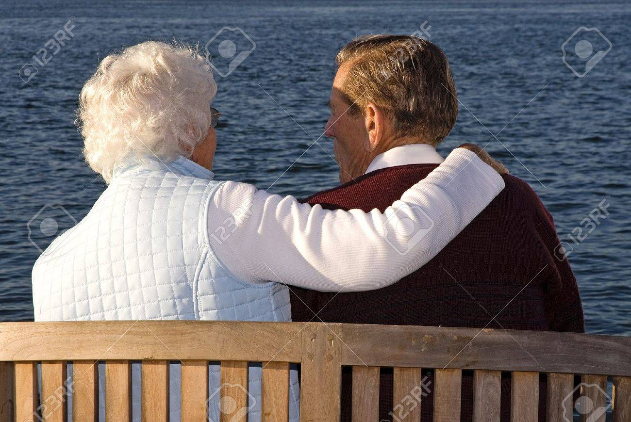 Caring couple sitting and enjoying the sunset - 9385789