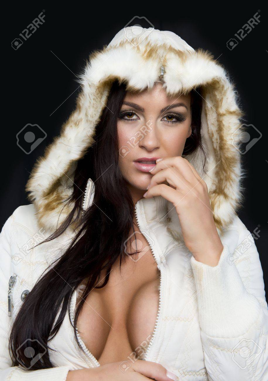 Attractive model poses with a white winter coat - 38079092