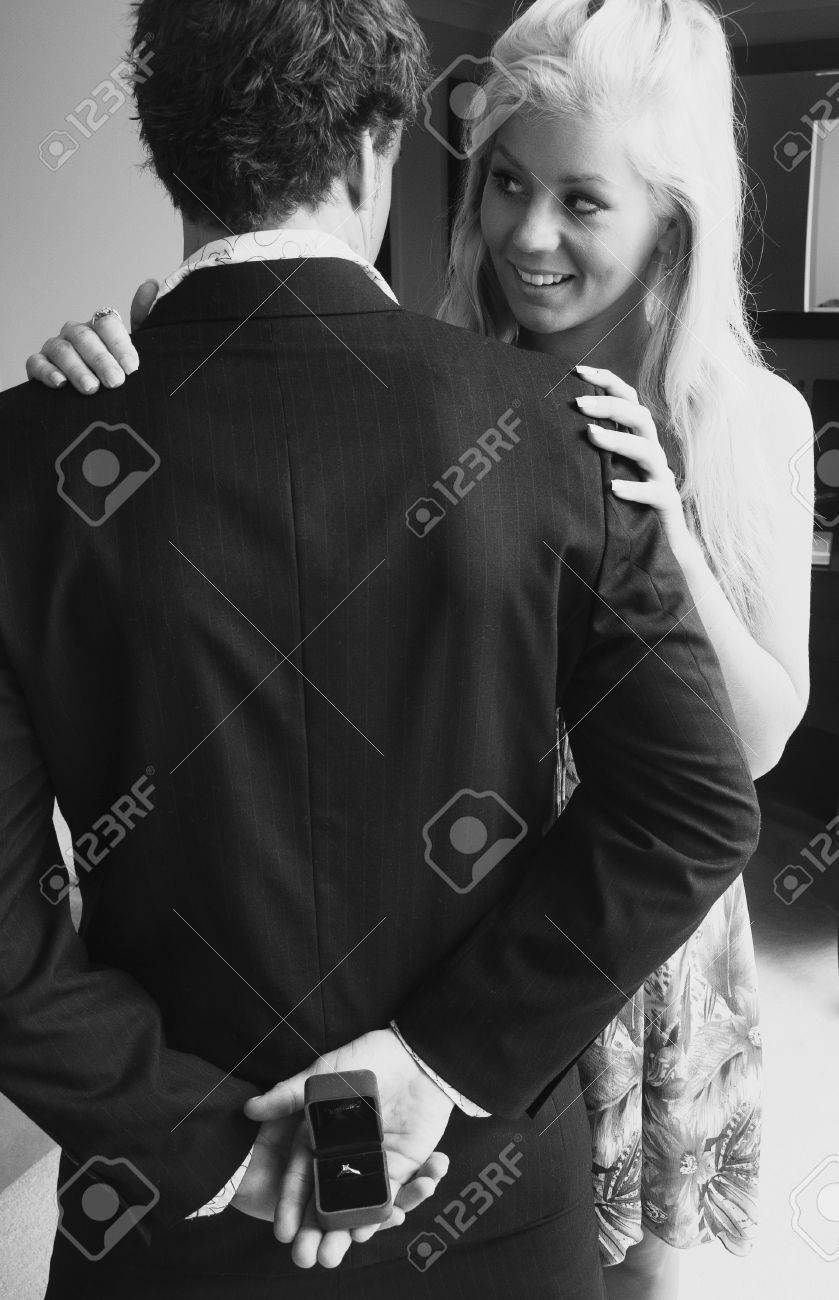 Young couple getting engaged - 38079216