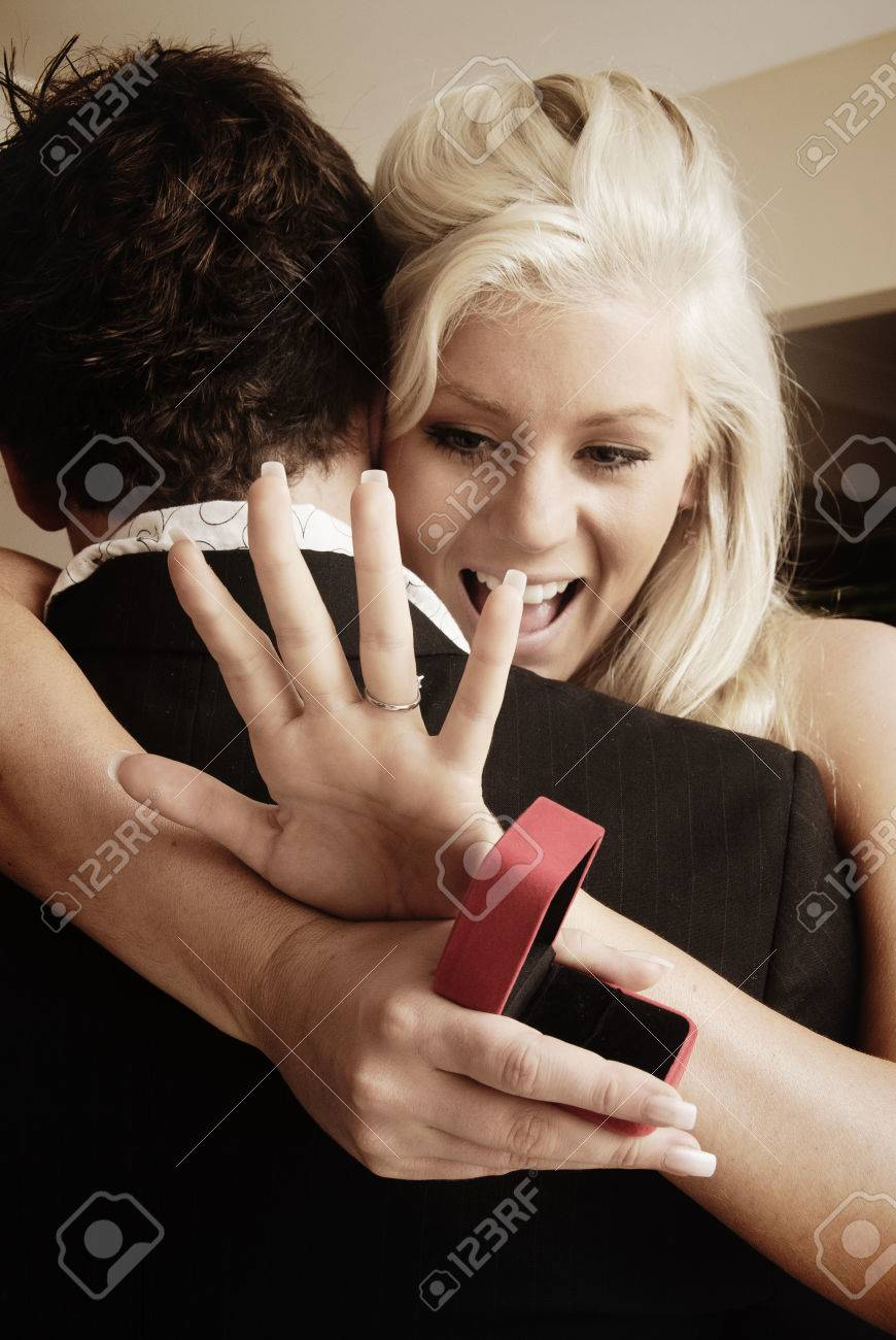 Young couple getting engaged - 38079496