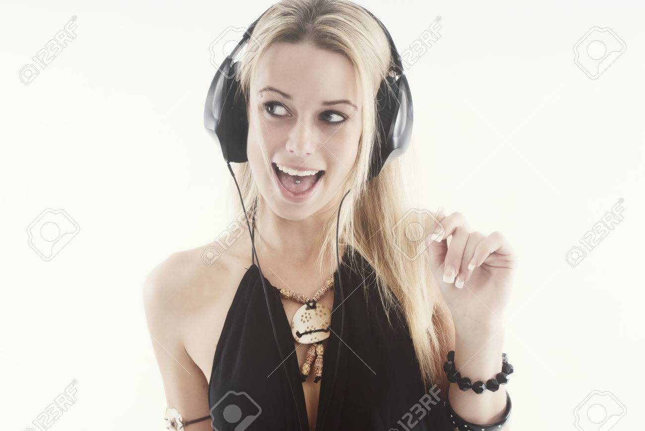 Young woman listening to music with headphones - 38081013