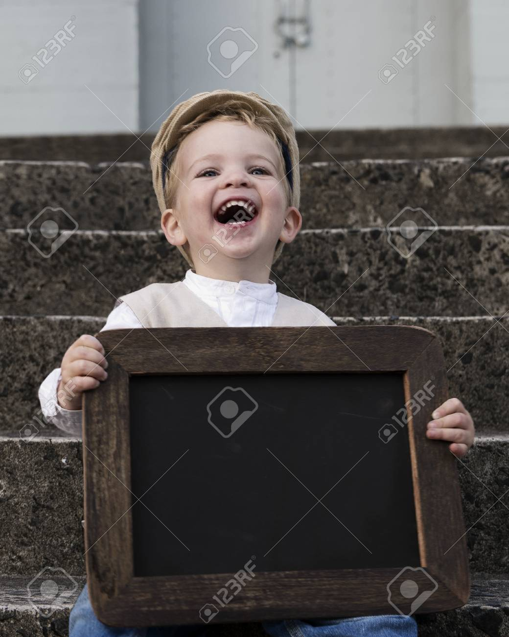 Young boy with chalkboard - 38742728