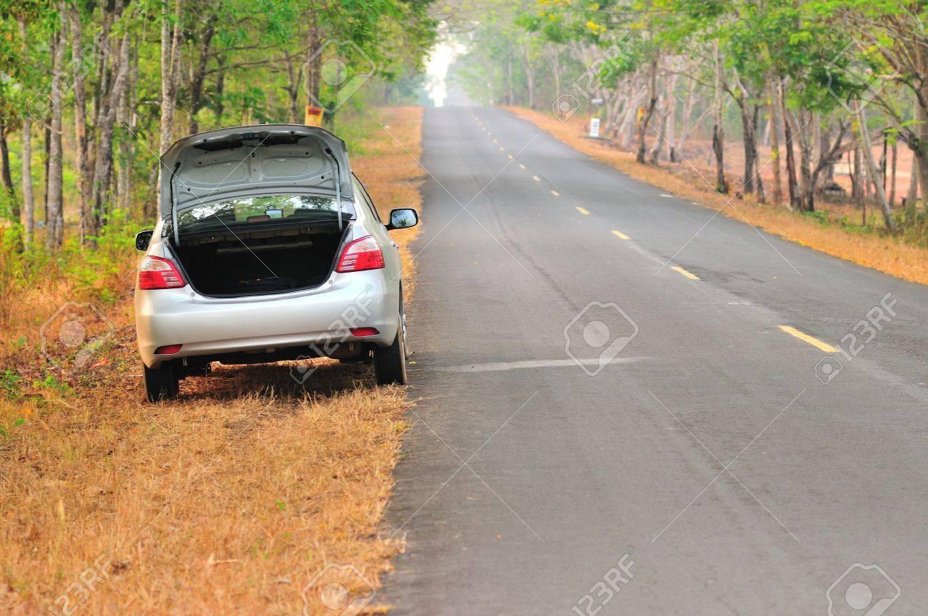 broken-down car on an asphalt road Stock Photo - 21559756