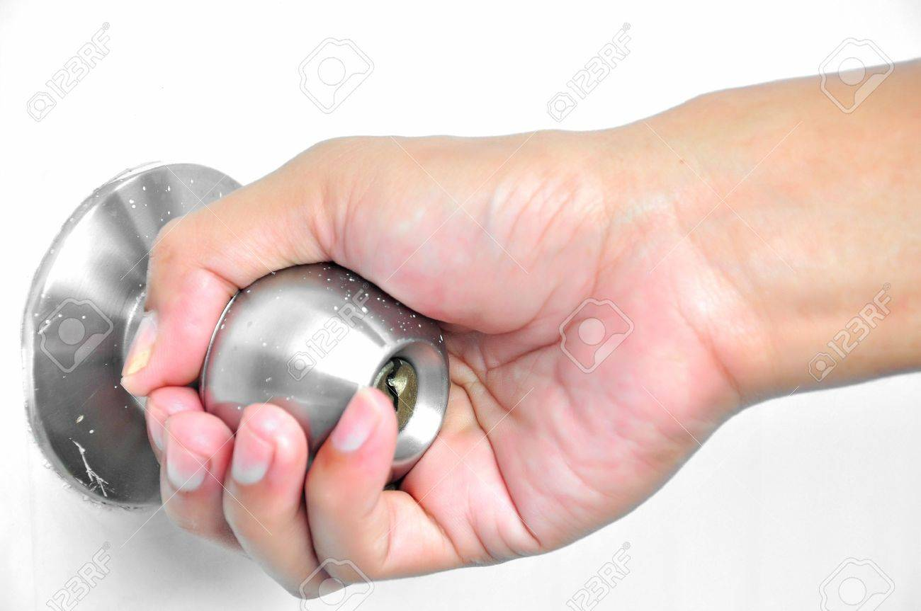Door with steel knob, being turned by man hand. More Real Estate. Stock Photo - 15046832