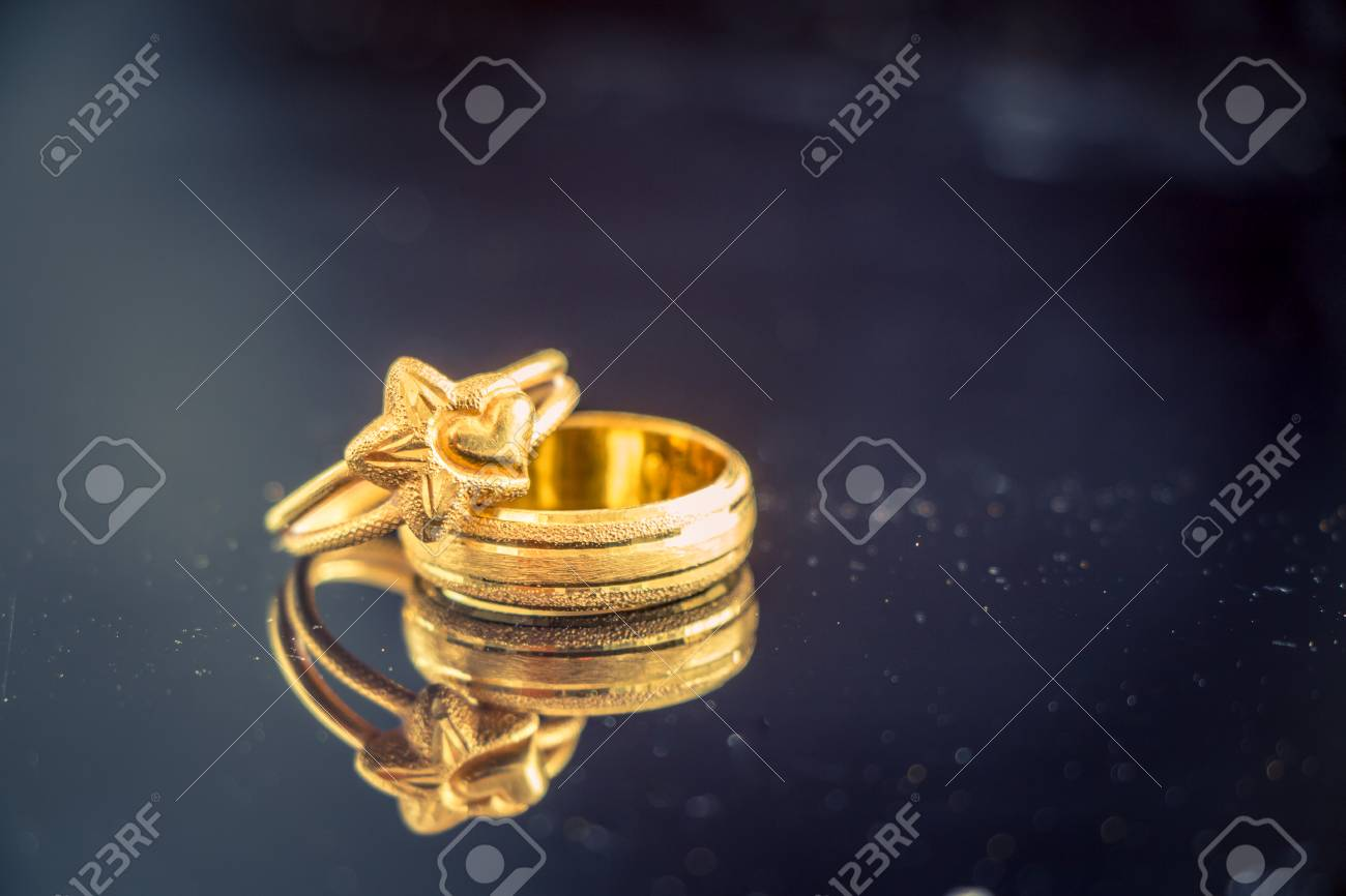 golden ring put on the table (Love concept) - 37912411