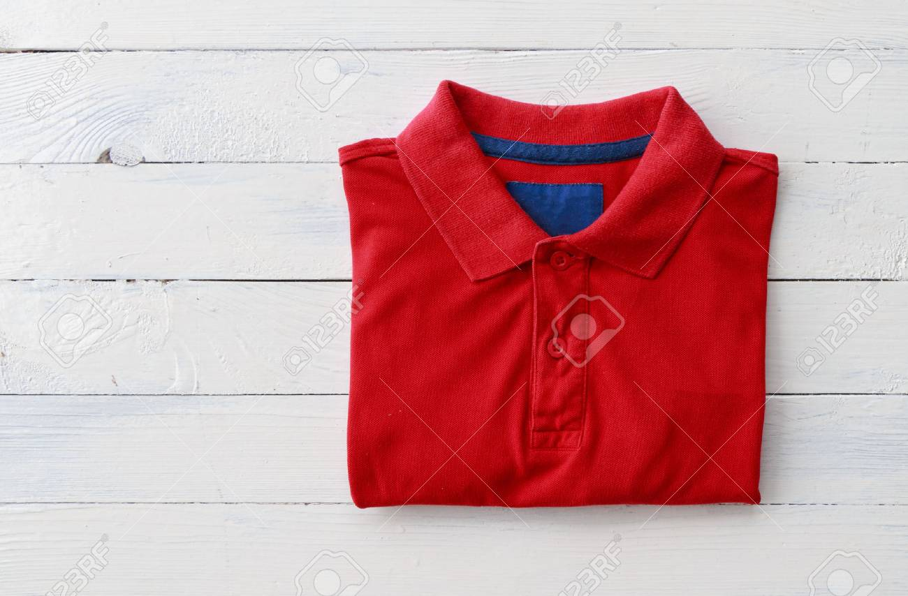 Close up top view of man polo shirt put on rustic wooden table top with blank space use for texts display - 89534353