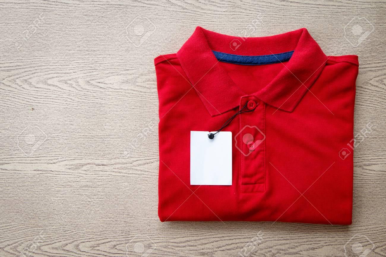 Close Up Polo Shirt Put On Wooden Tabletop Lizenzfreie Fotos Bilder