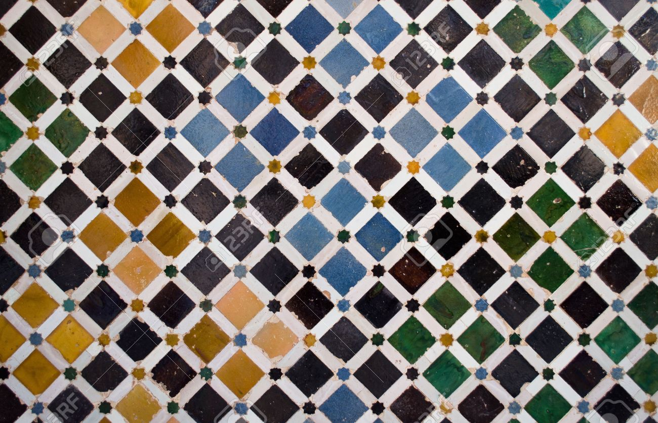 Pattern or texture of ceramic tiles mosaic found in the alhambra pattern or texture of ceramic tiles mosaic found in the alhambra in spain stock photo dailygadgetfo Images