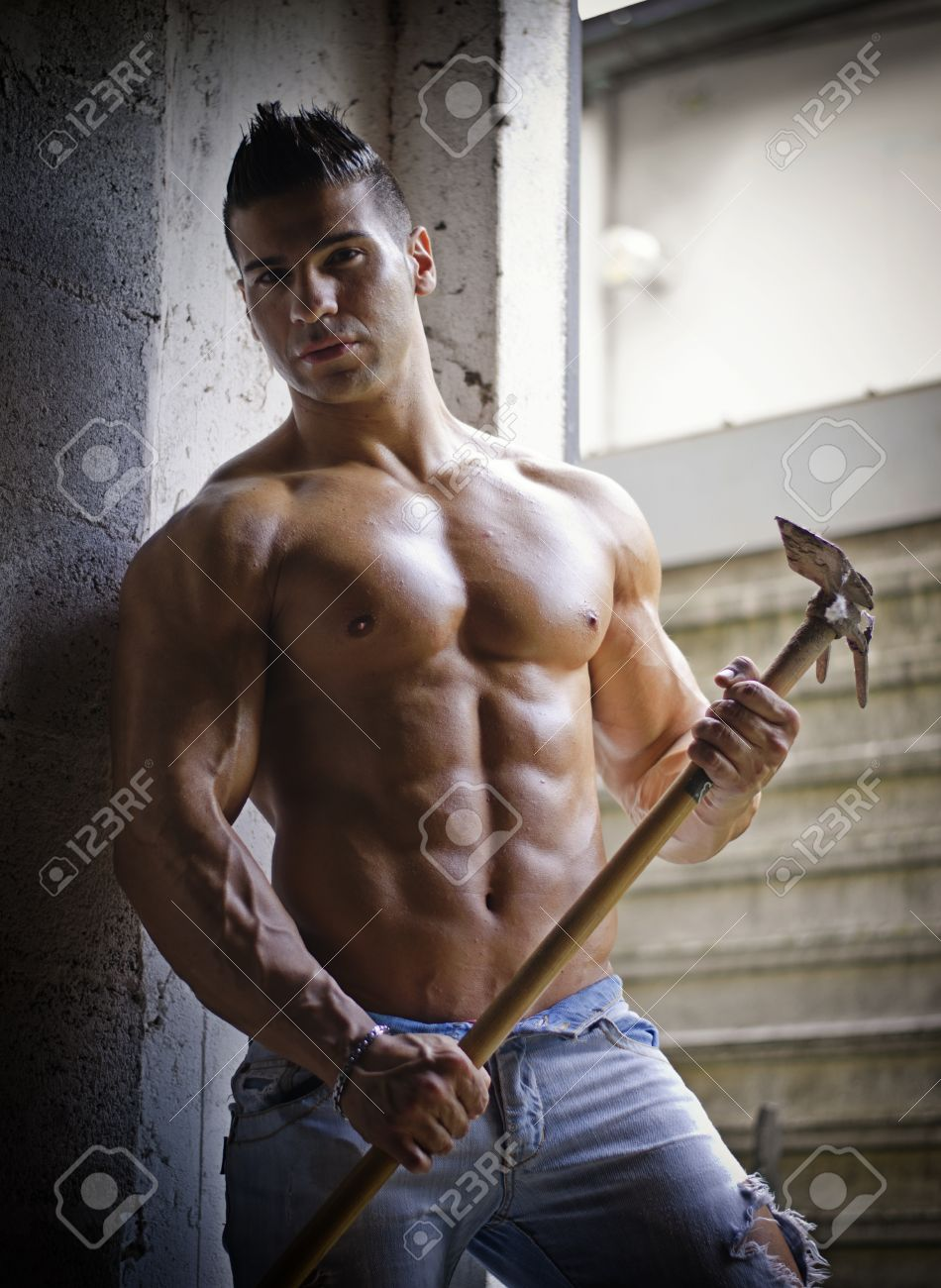 549efefd2a5f Muscular Shirtless Young Man Holding Farming Tool In His Hands ...