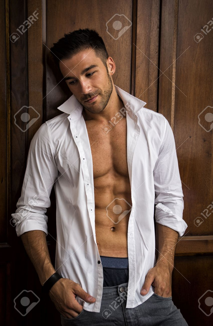 Sexy Handsome Young Man Standing In White Open Shirt With A Smile ...