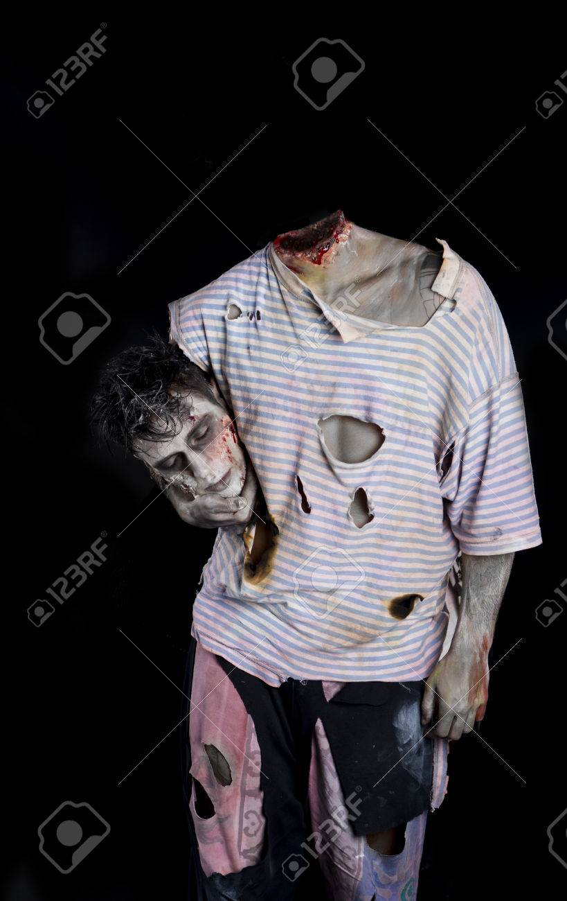 32370795-decapitated-zombie-holding-his-own-head-under-his-arm.jpg