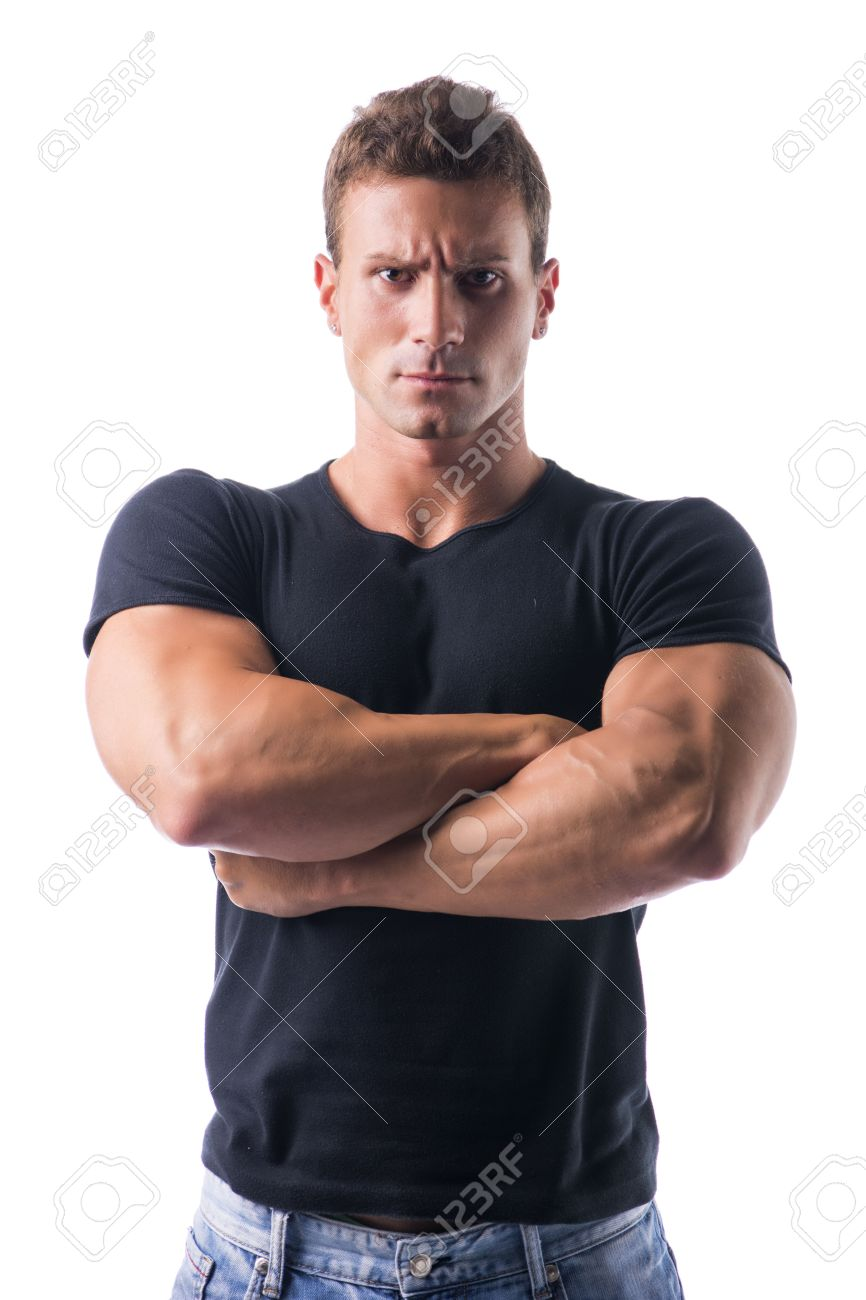 Confident Young Muscled Man In Black Shirt Crossing Arms In Front ...
