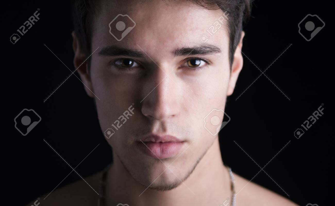 Closeup Headshot Of Handsome Young Man Dark Hair And Brown Eyes