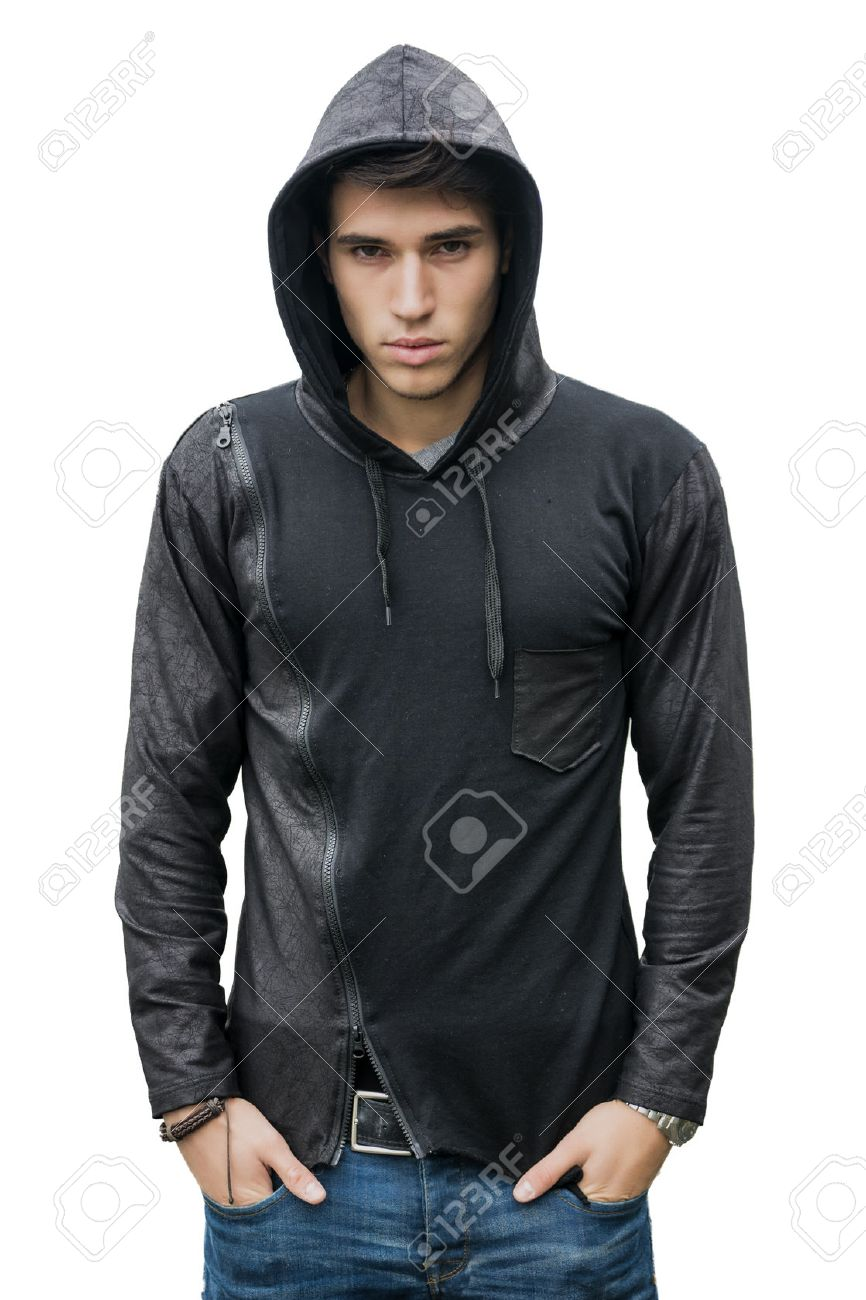 886aaefed76 Handsome young man in black hoodie sweater isolated on white looking at  camera Stock Photo -
