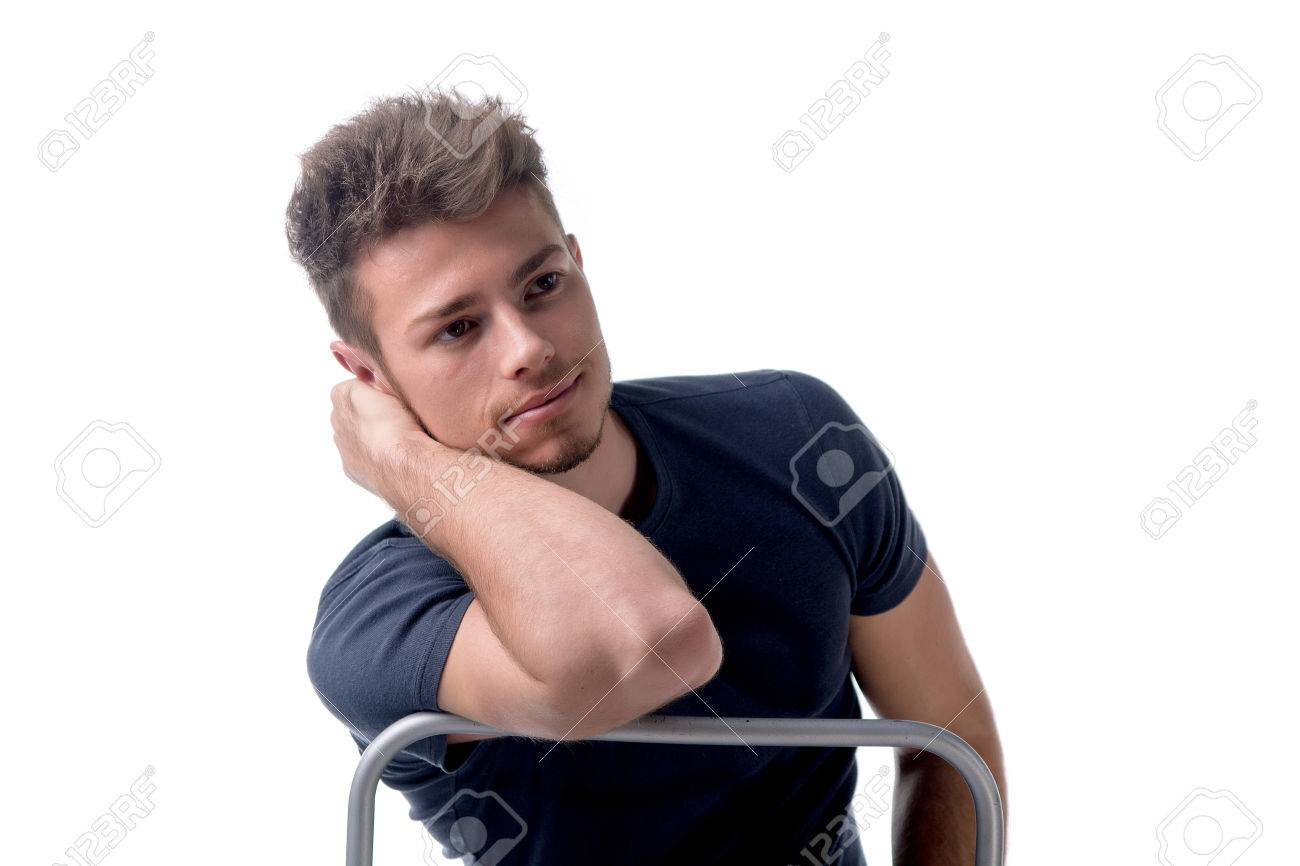 Man sitting in chair side - Attractive Young Man Sitting Leaning On Back Of A Chair Looking Away To A Side