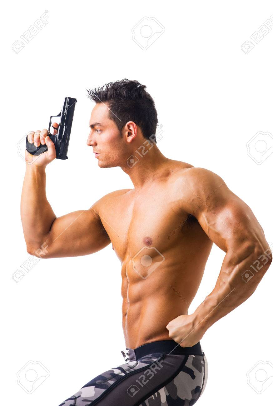 Half Body Shot Of A Handsome Athletic Man With No Shirt Holding