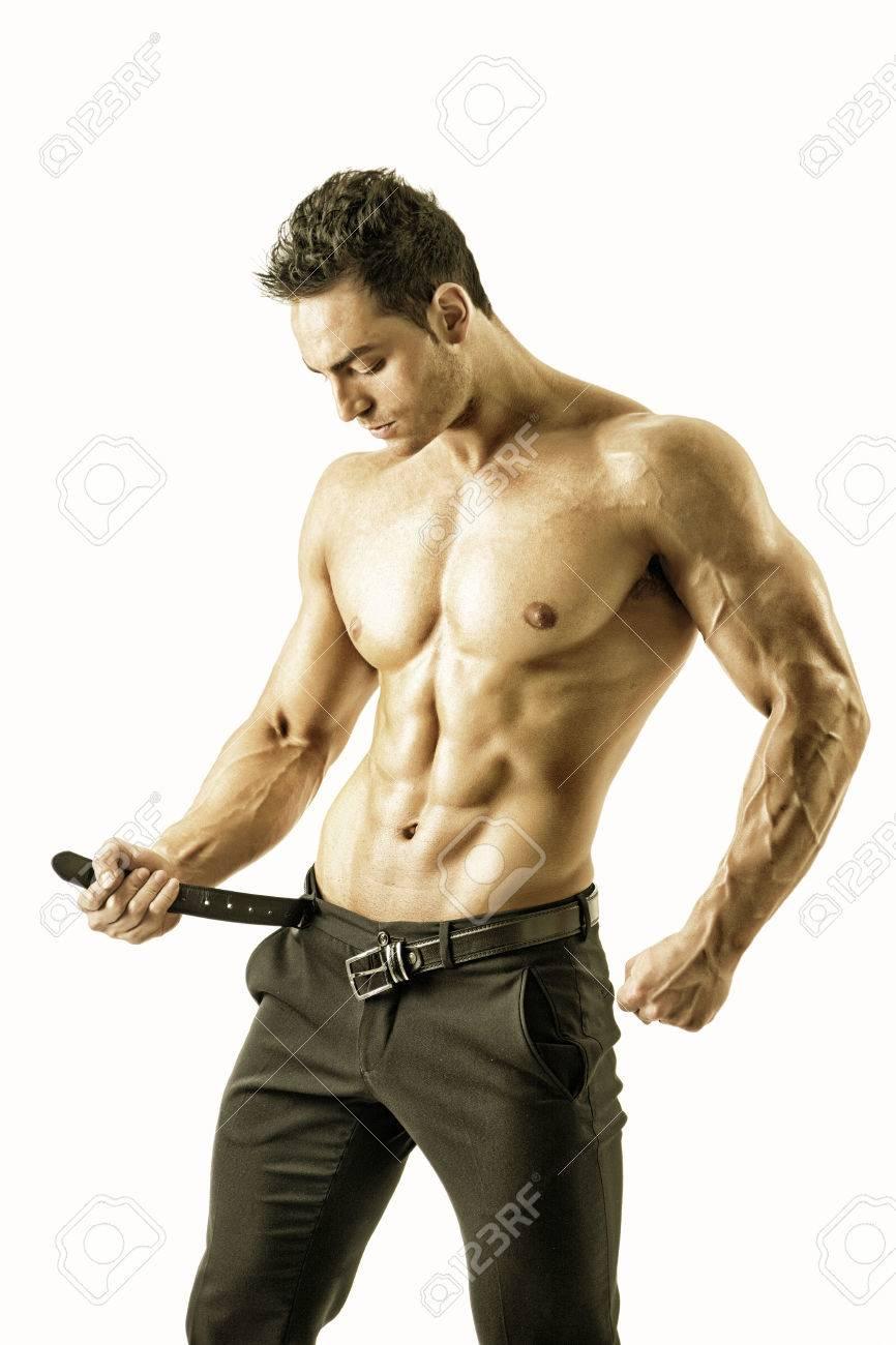 Hombre Muscular Descamisado Hermoso Quitandose Los Pantalones Elegantes De Pie Aislado En Fondo Blanco Fotos Retratos Imagenes Y Fotografia De Archivo Libres De Derecho Image 39480825