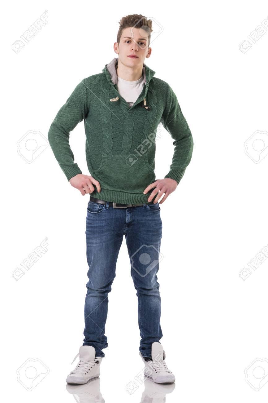 Atractivos Jovenes De Moda Hombre Con Pantalones Vaqueros Y Sueter De Punto Verde Aislados En Fondo Blanco Mirando A La Camara Fotos Retratos Imagenes Y Fotografia De Archivo Libres De Derecho Image