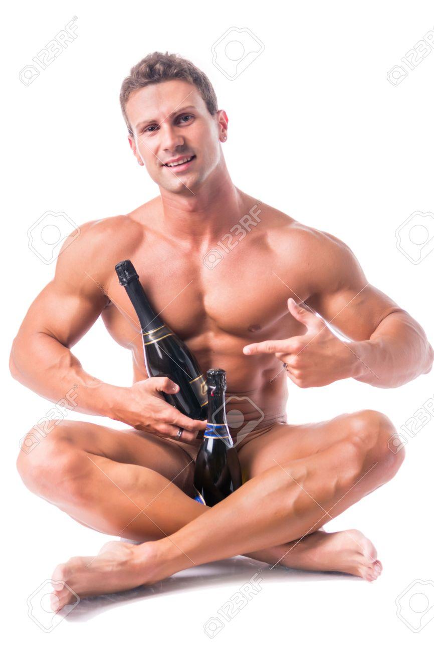 Muscle Nue Torse Nu Jeune Homme Sexy Avec Une Bouteille De Champagne Assis Sur Le Plancher Isole Sur Fond Blanc Banque D Images Et Photos Libres De Droits Image 44084906