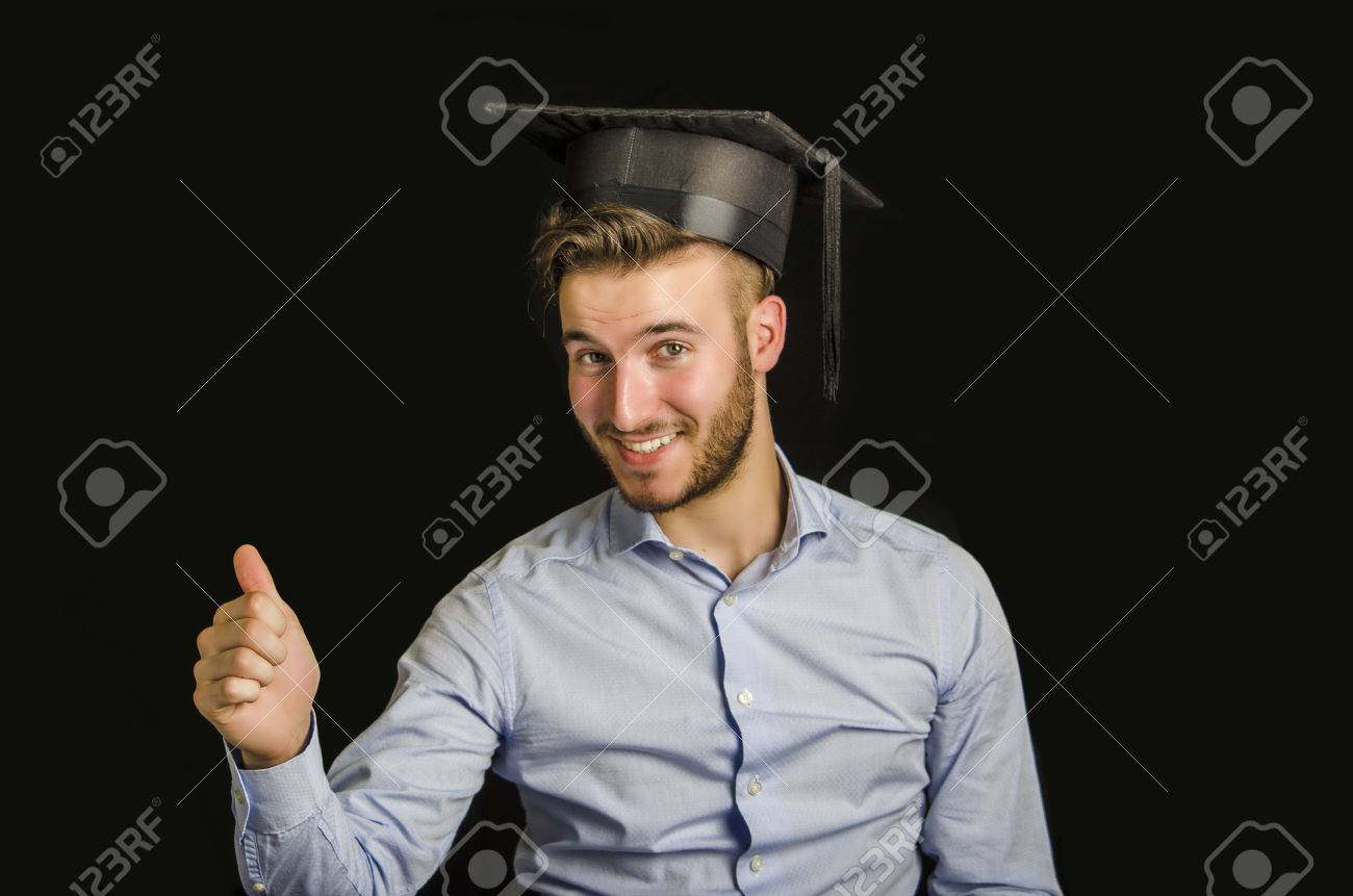 happy young man graduating from college graduation hat happy young man graduating from college graduation hat doing thumb up sign stock