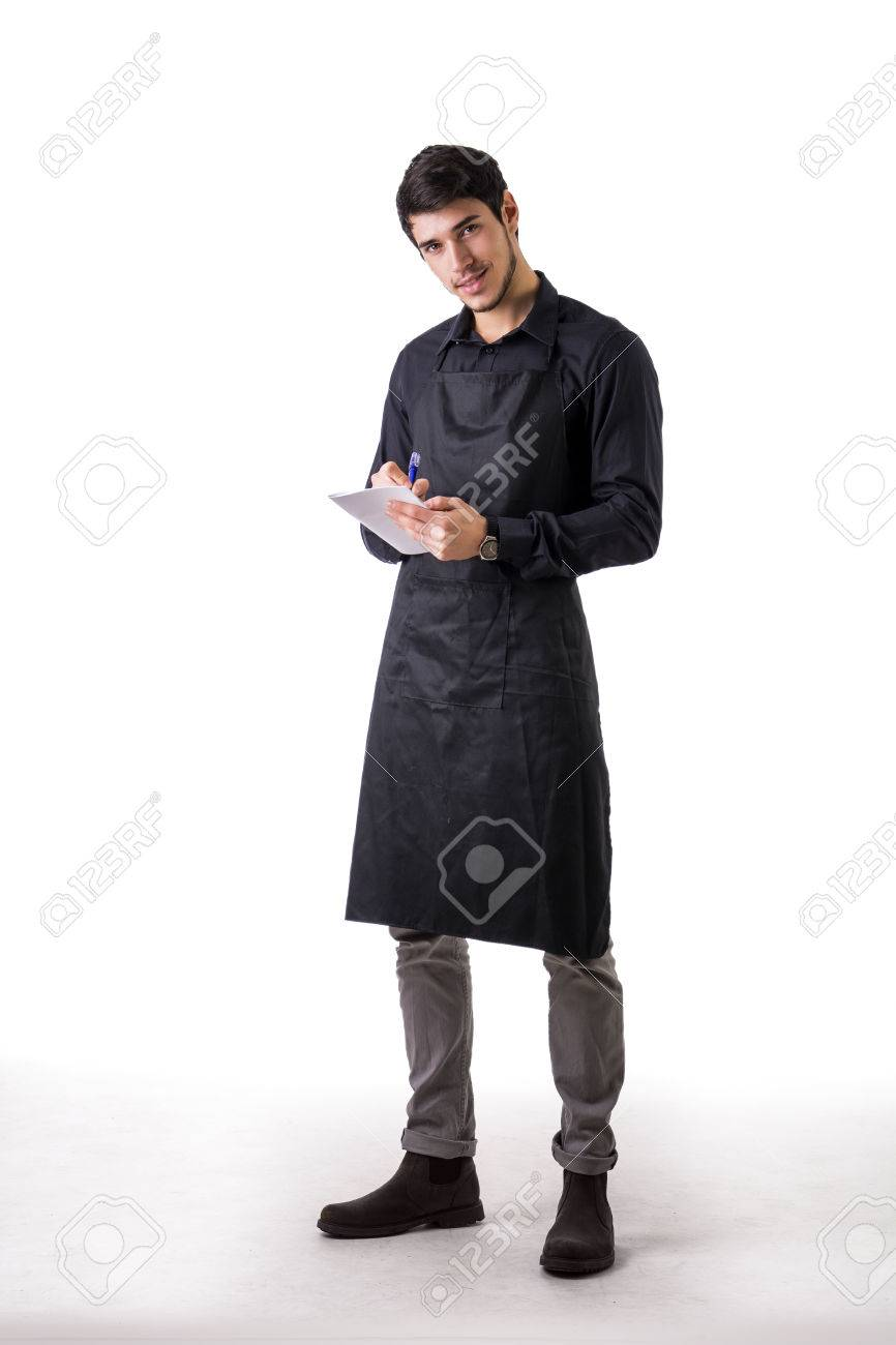 full length shot of young chef or waiter posing wearing black