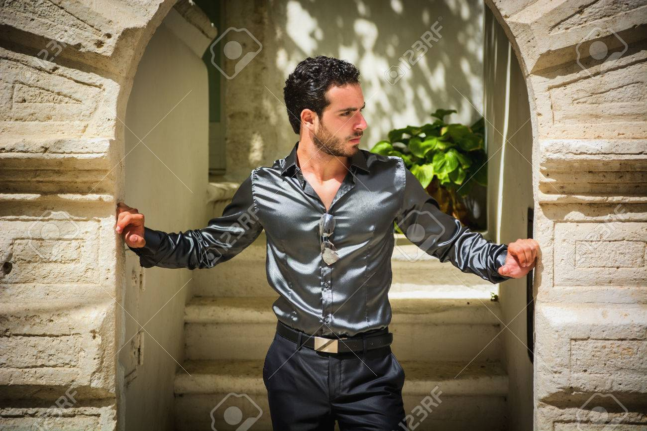 Portrait of handsome bearded man wearing elegant clothes and looking away in Ostuni, Puglia, in Italy - 55951907