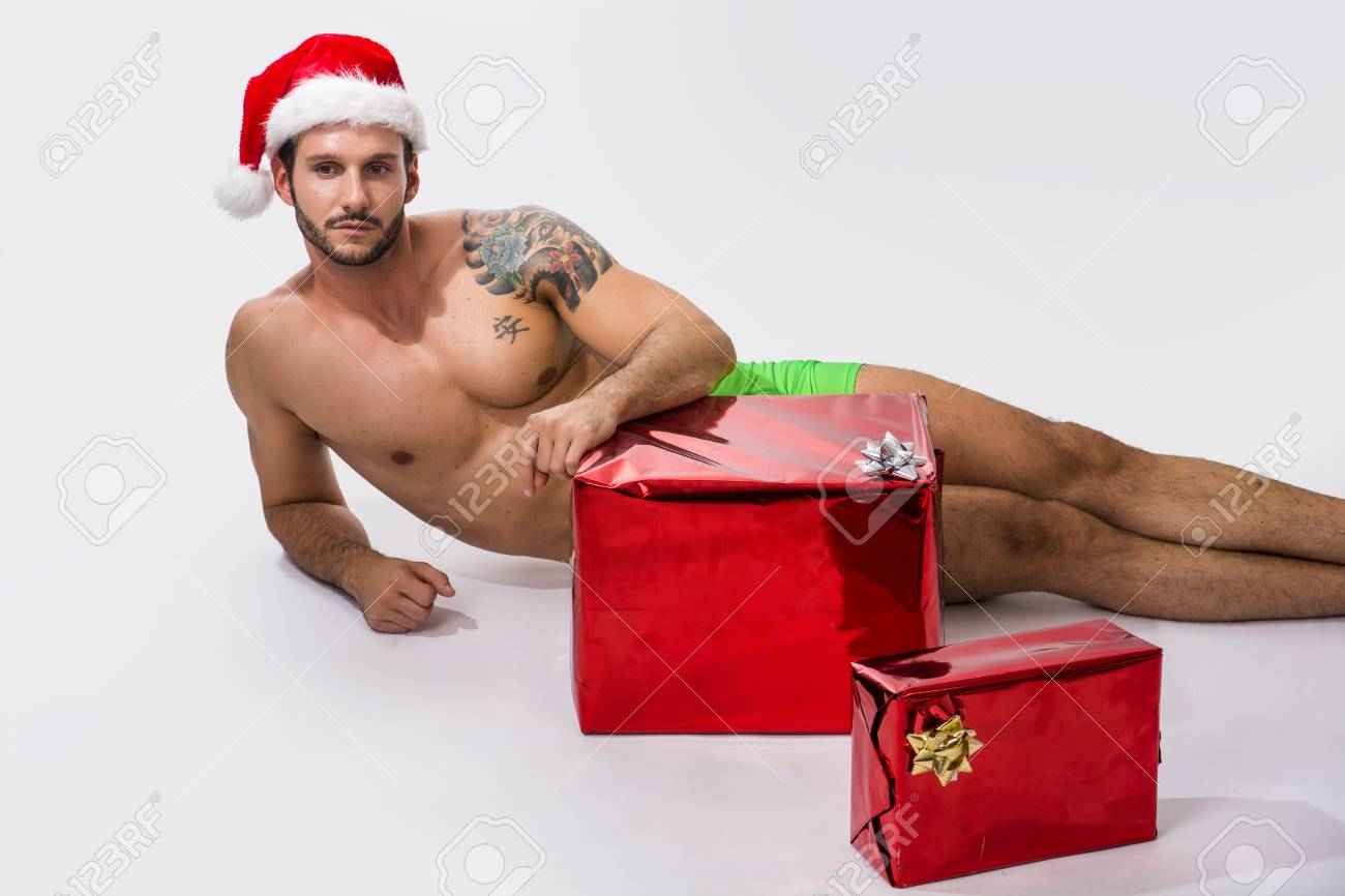 Pere Noel Nu Muscular Shirtless Young Man In Santa Claus Hat Standing Holding