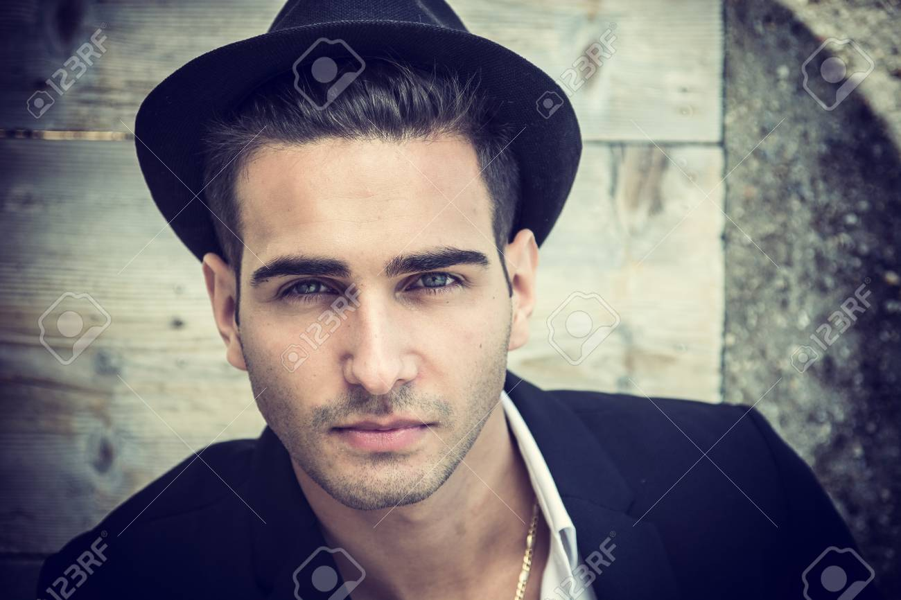e44263c58ac40 Headshot of handsome young man outdoor in the sun with fedora hat Stock  Photo - 75396474