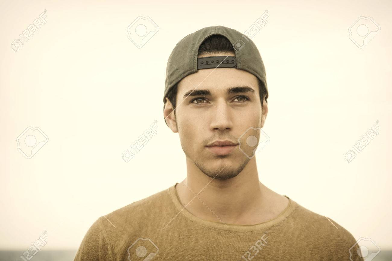 c546087fb80 Portrait Of Handsome Young Man Outside Wearing Baseball Cap