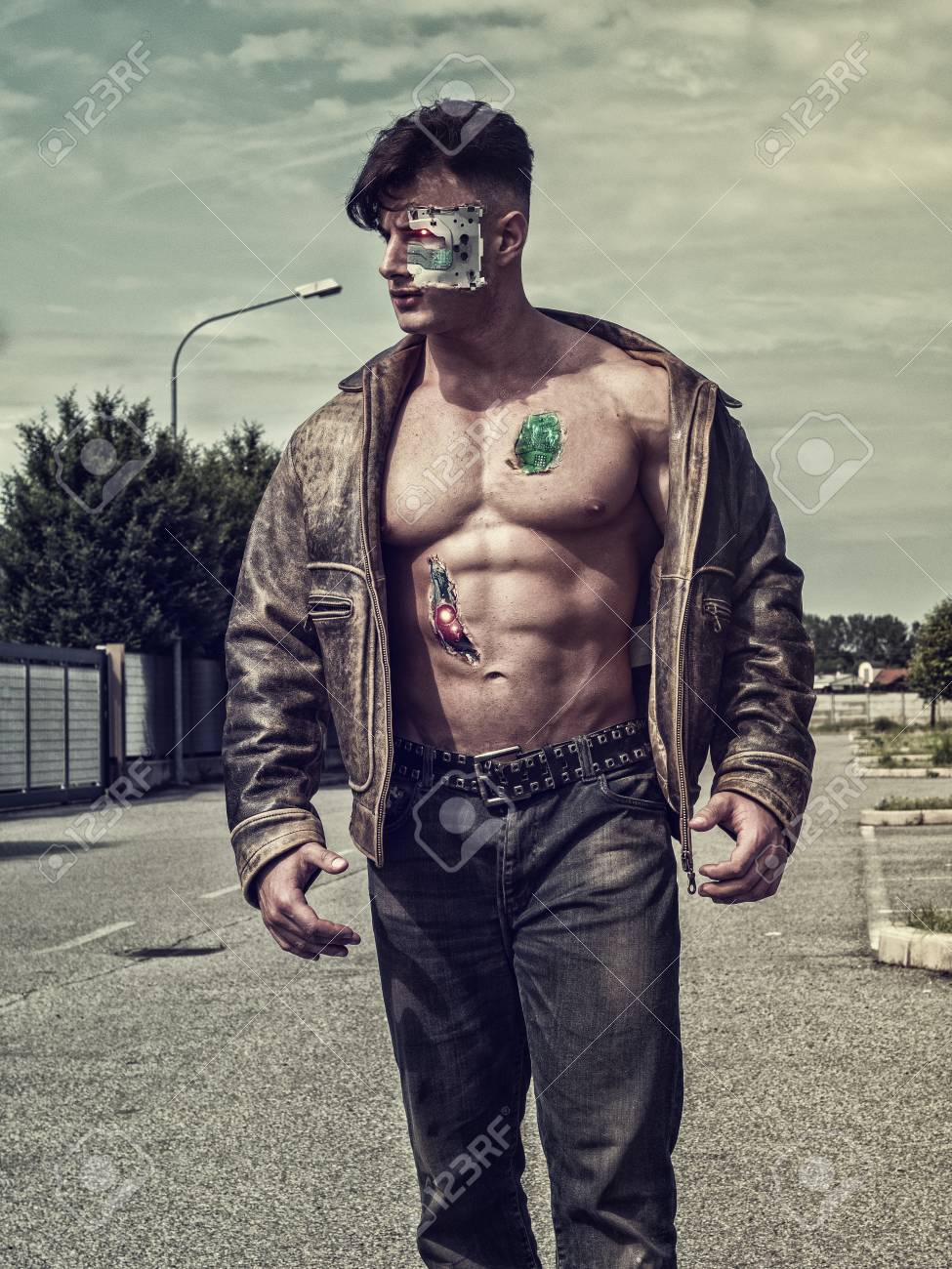 104724959-young-handsome-robotic-man-wearing-leather-jacket-walking-in-the-street-showing-sexy-body-abs-while-.jpg