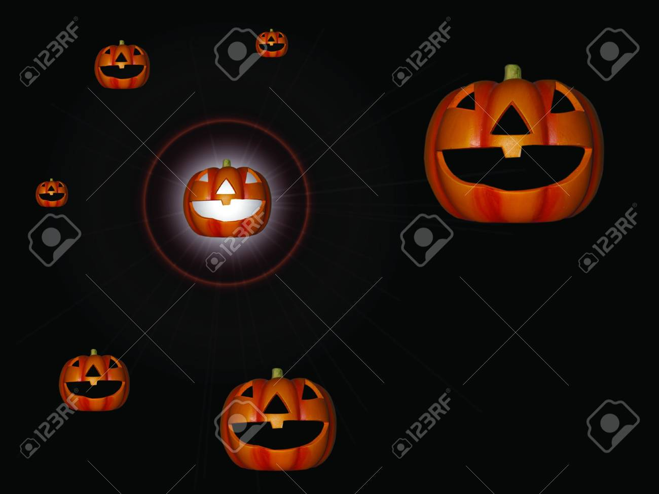 a family of pumpkins with a bright light shining from one Stock Photo - 5534696