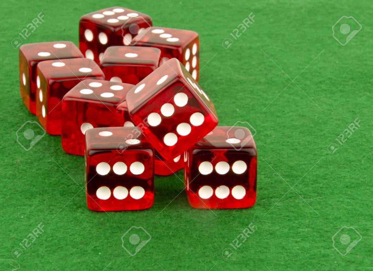 multiple red dice on green cloth Stock Photo - 16196002