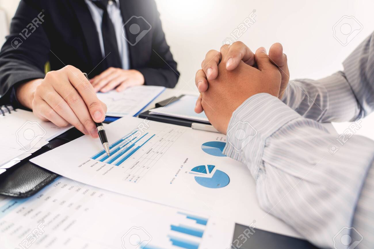 Business Corporate team brainstorming, Planning Strategy having a discussion Analysis investment researching with chart at office his desk documents and saving concept. - 122485939